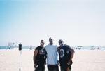 Darnell Self(millionaire), Charles Robinson(me), Mike Humes(millionaire) playing football in Huntington Beach California